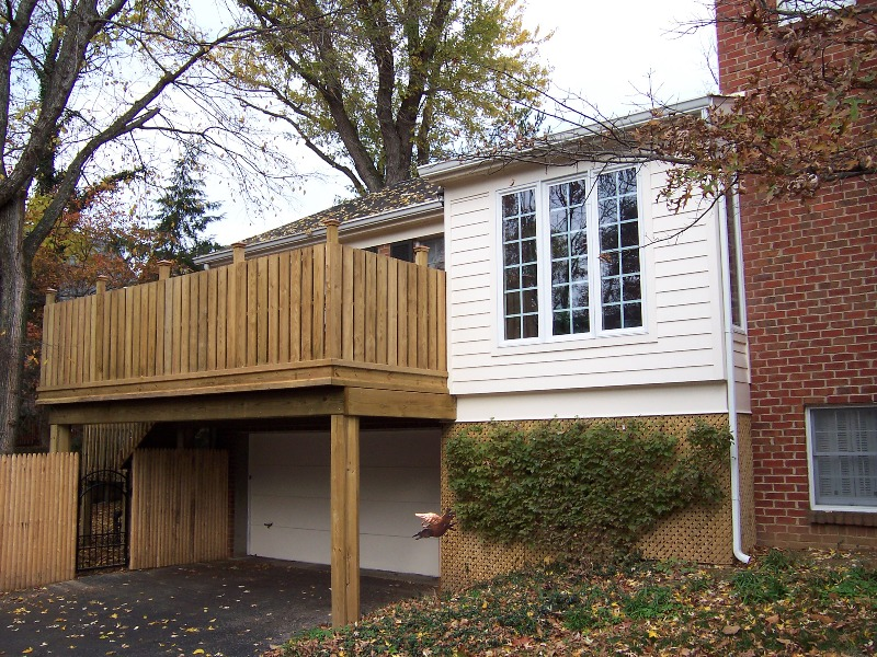 Features privacy railing and converted 3 season to family room space.