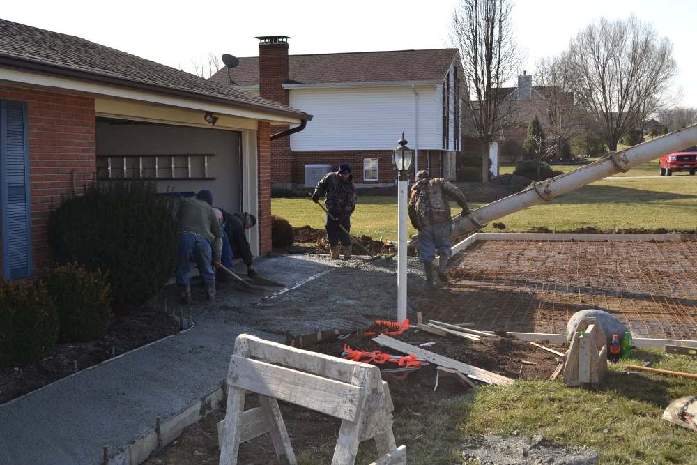 Link to images of a concrete driveway construction supervised by Lou Vaughn.
