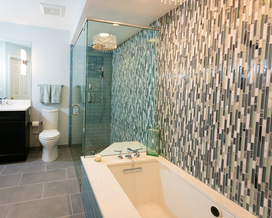 Modern bathtub and shower combination. Undermount tub and therapeutic features included.