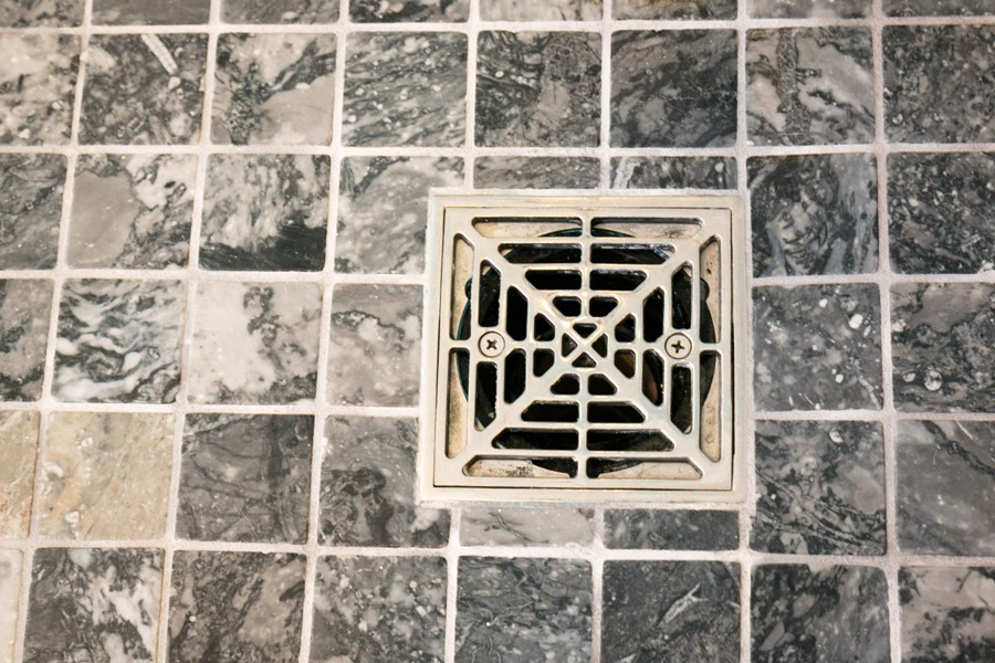 Custom shower floor drain in a modern bathroom remodel.