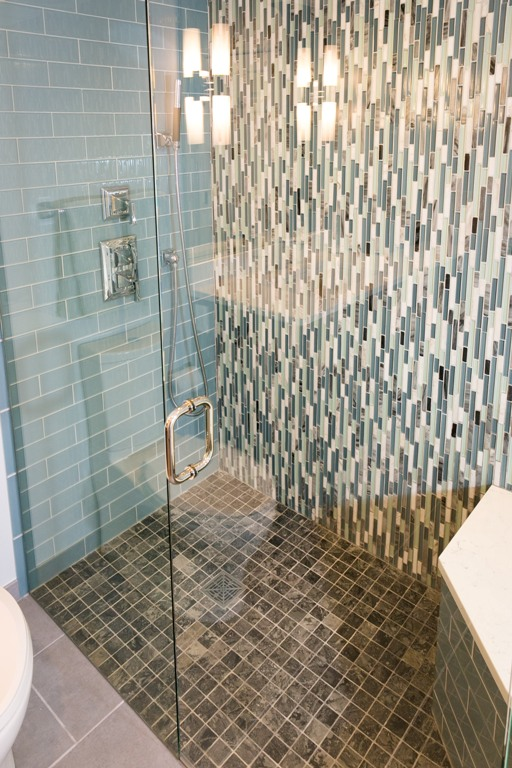 The modern bathroom with Milky Black Tumbled 2 x 2 inch shower floor.