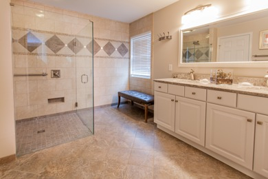 Bathroom remodel with curbless shower feature.