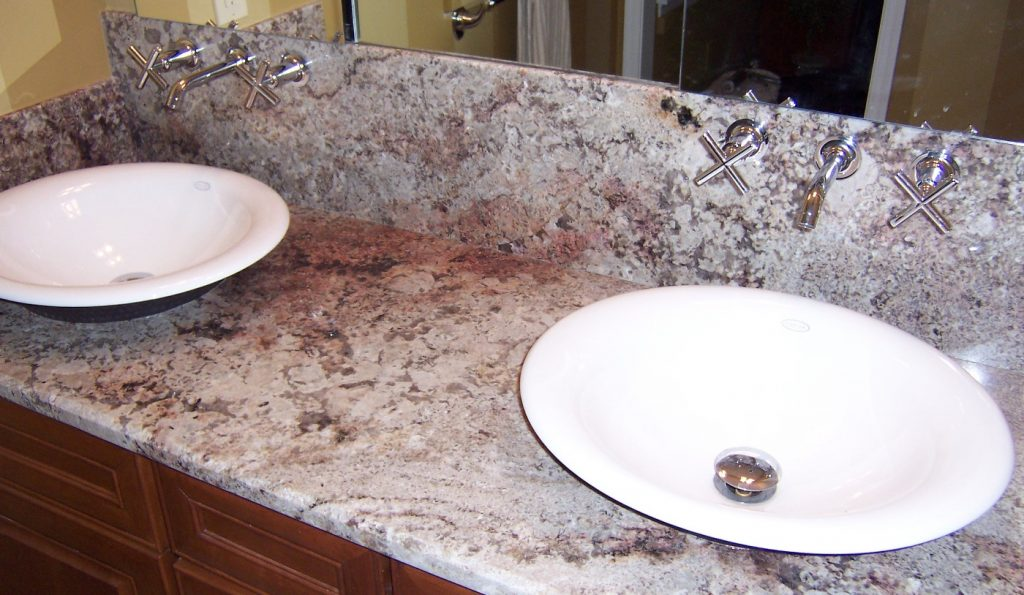 Wall mounted faucets and vessel sink bowl configuration.